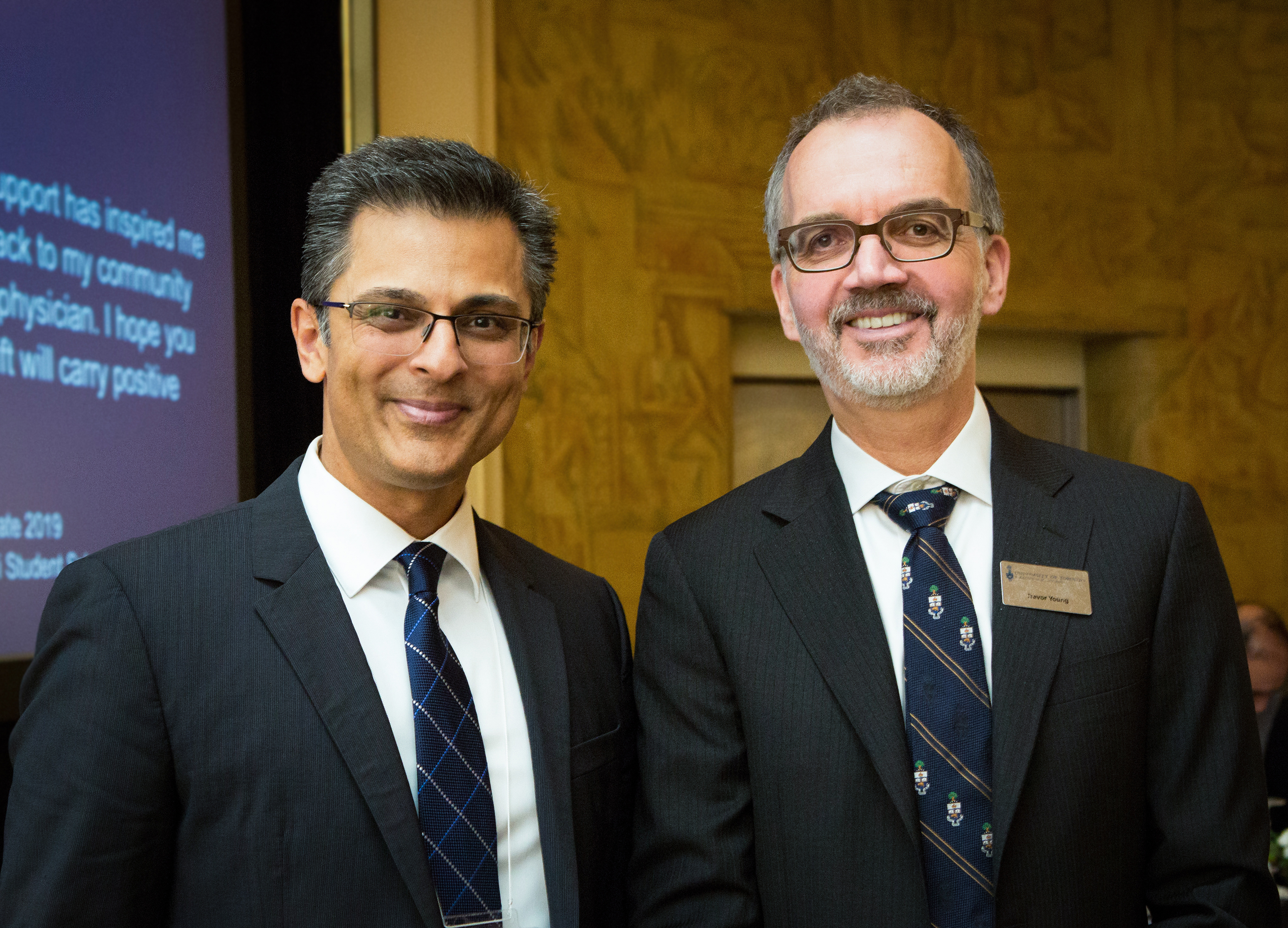 Dr. Muhammad Mamdani and Dean Trevor Young