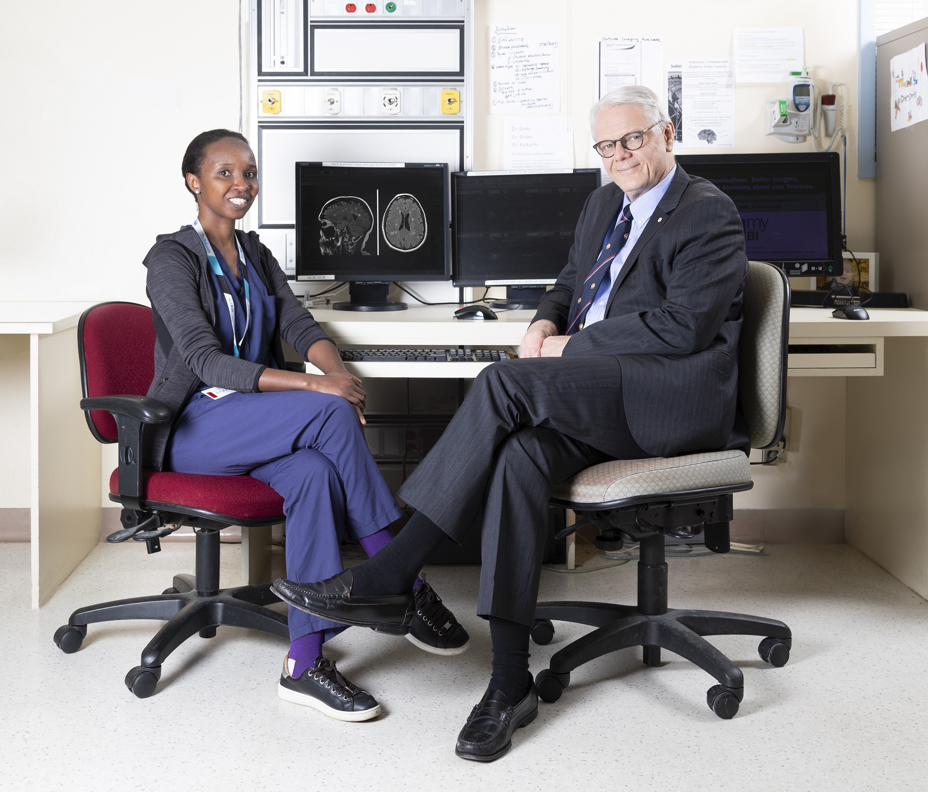 Prakash Fellow Dr. Grace Muthoni with Surgery Chair Dr. James Rutka. Photo by Matt Volpe