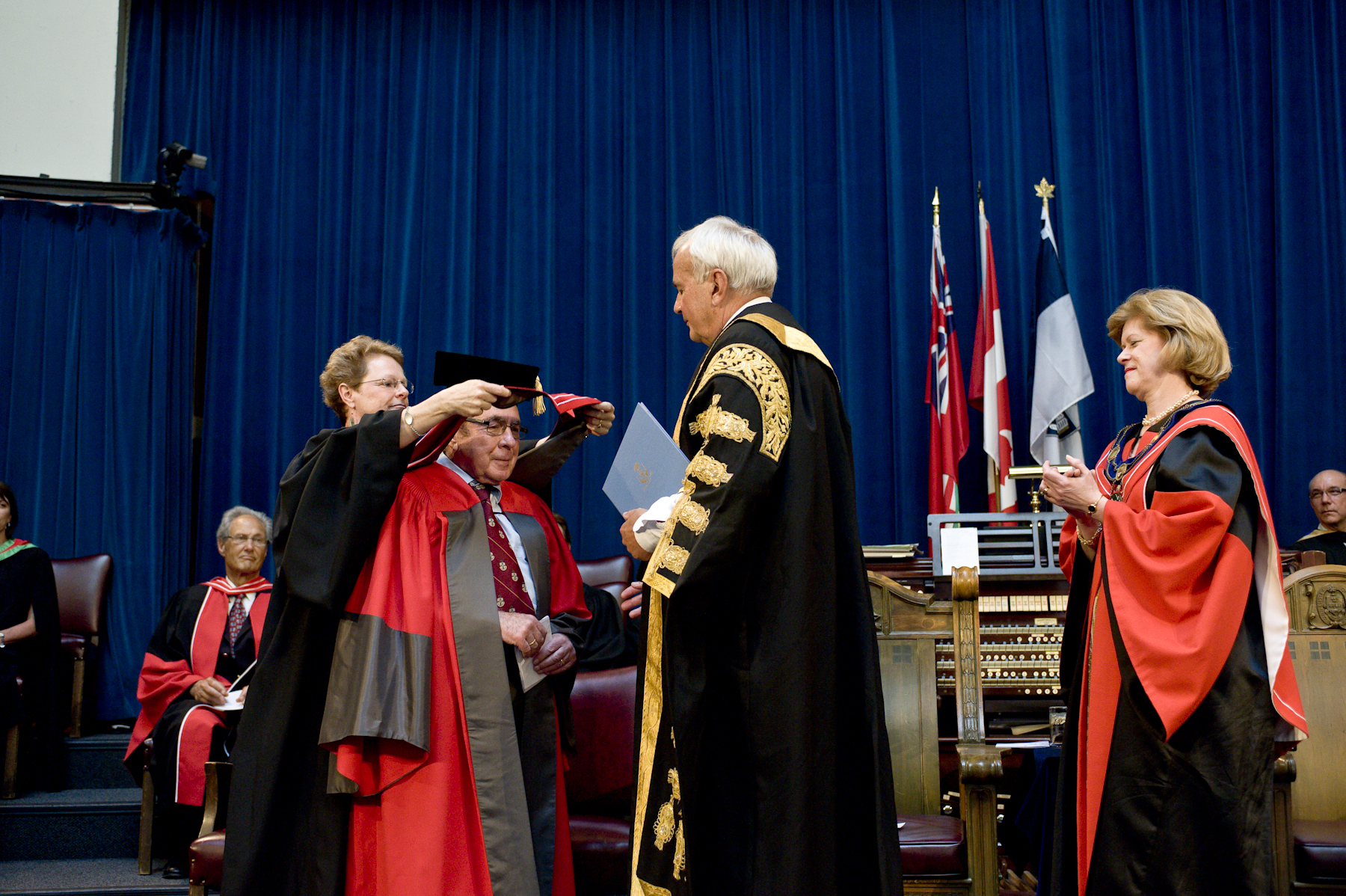 Prof. Patricia Brubaker hoods Prof. Emeritus Mladen Vranic at honorary degree ceremony